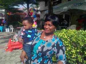 Mummy with Kobby, my nephew on his first birthday