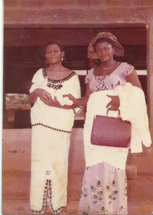 My Mum poses with her friend and my godmother outside Holy Spirit Parish, Omagba on the day of my baptism.